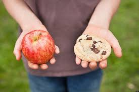 cookie and apple in hand